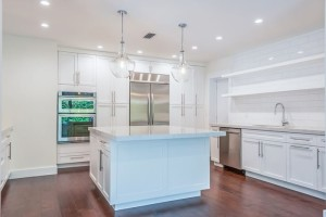 A dream kitchen has marbled quartz counters, high-end stainless appliances